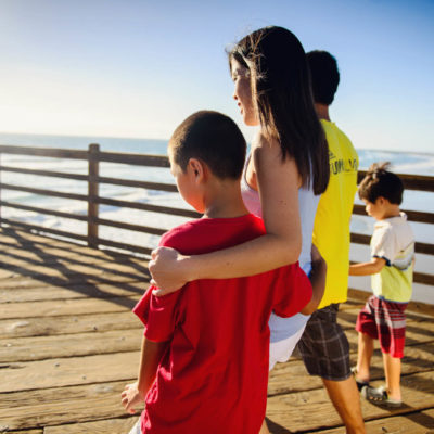 Family walking on the Oceanside Pier