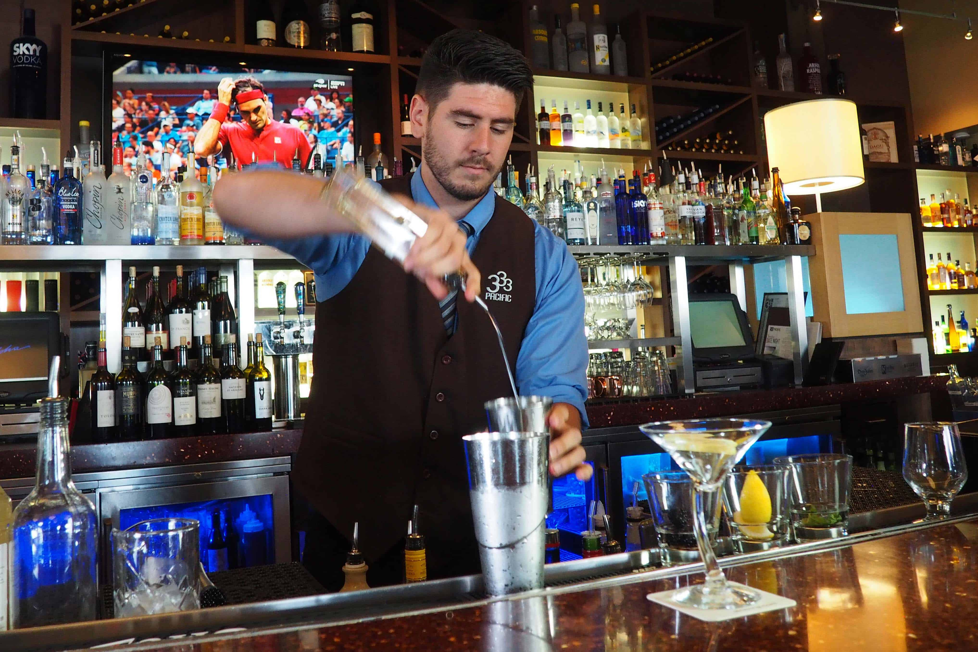 333 Pacific Lead Bartender Chandler Ervin Mixing a Cocktail