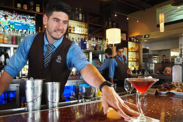 333 Pacific Lead Bartender Chandler Ervin Serving a Bramble On
