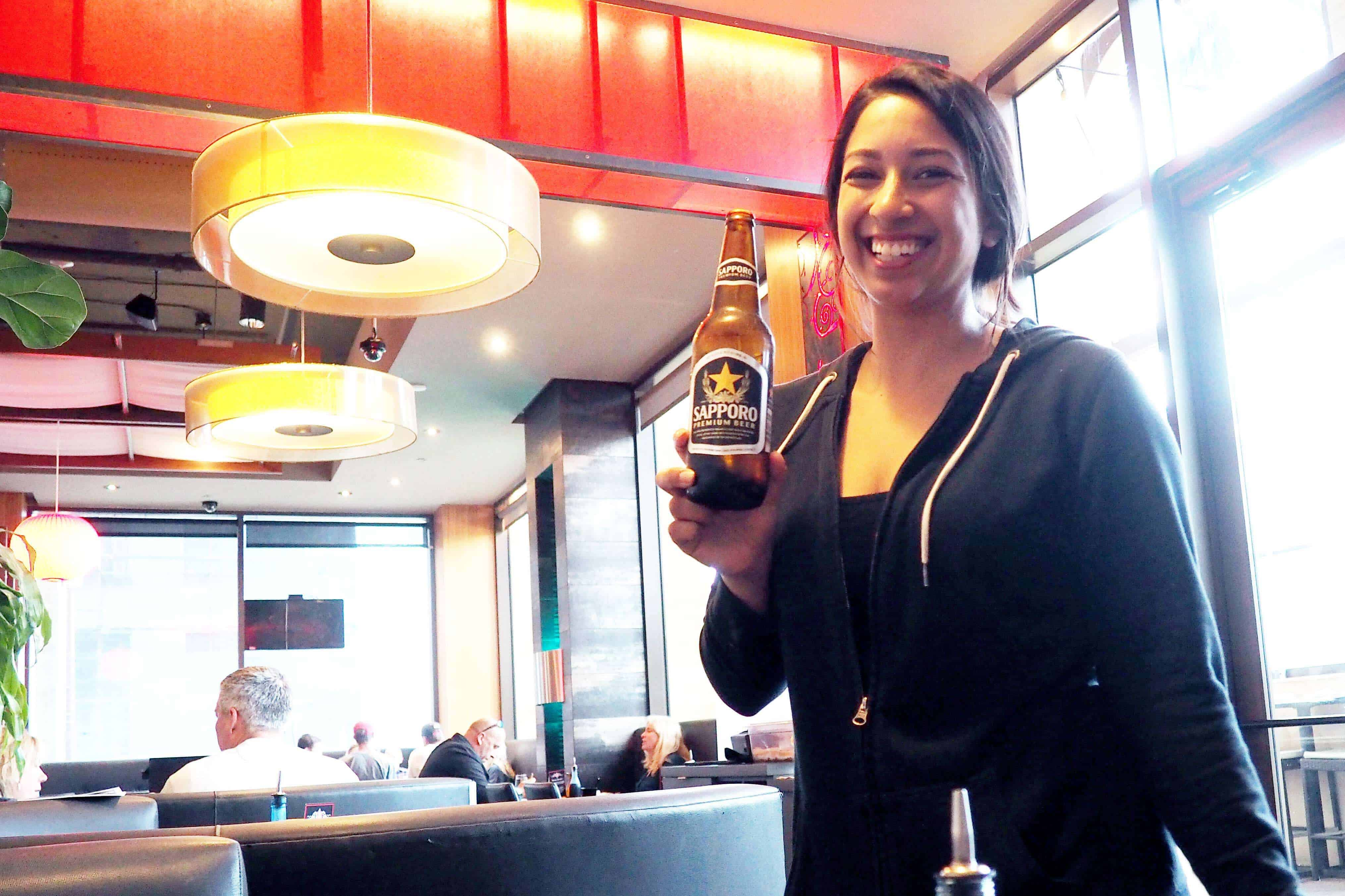 Harney Sushi Waitress Serving a Sapporo