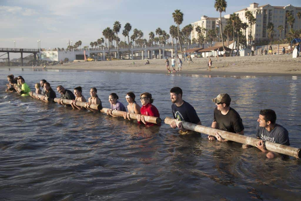 Team Building exercise in the Ocean waves