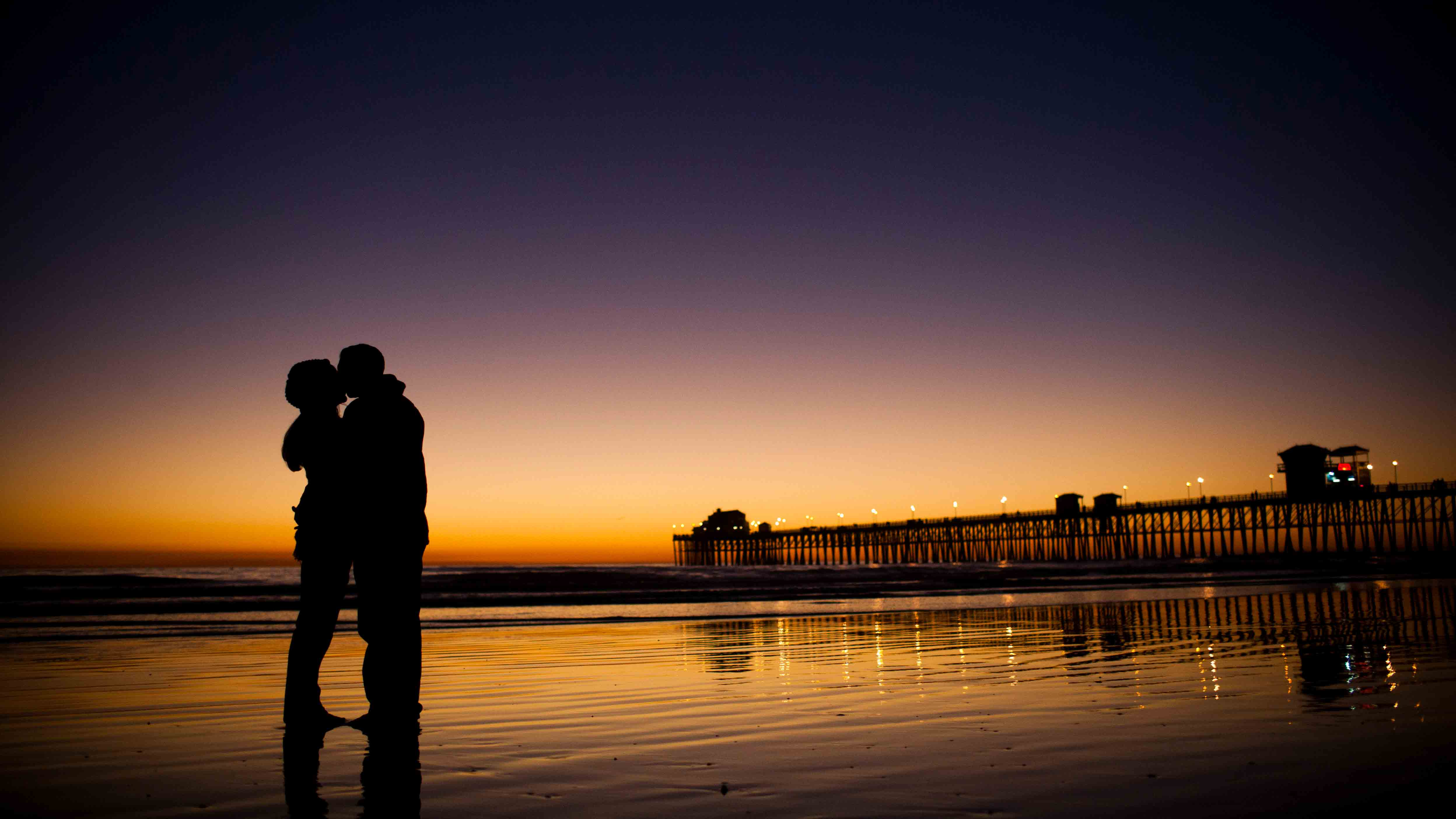 Oceanside pier sunset couple