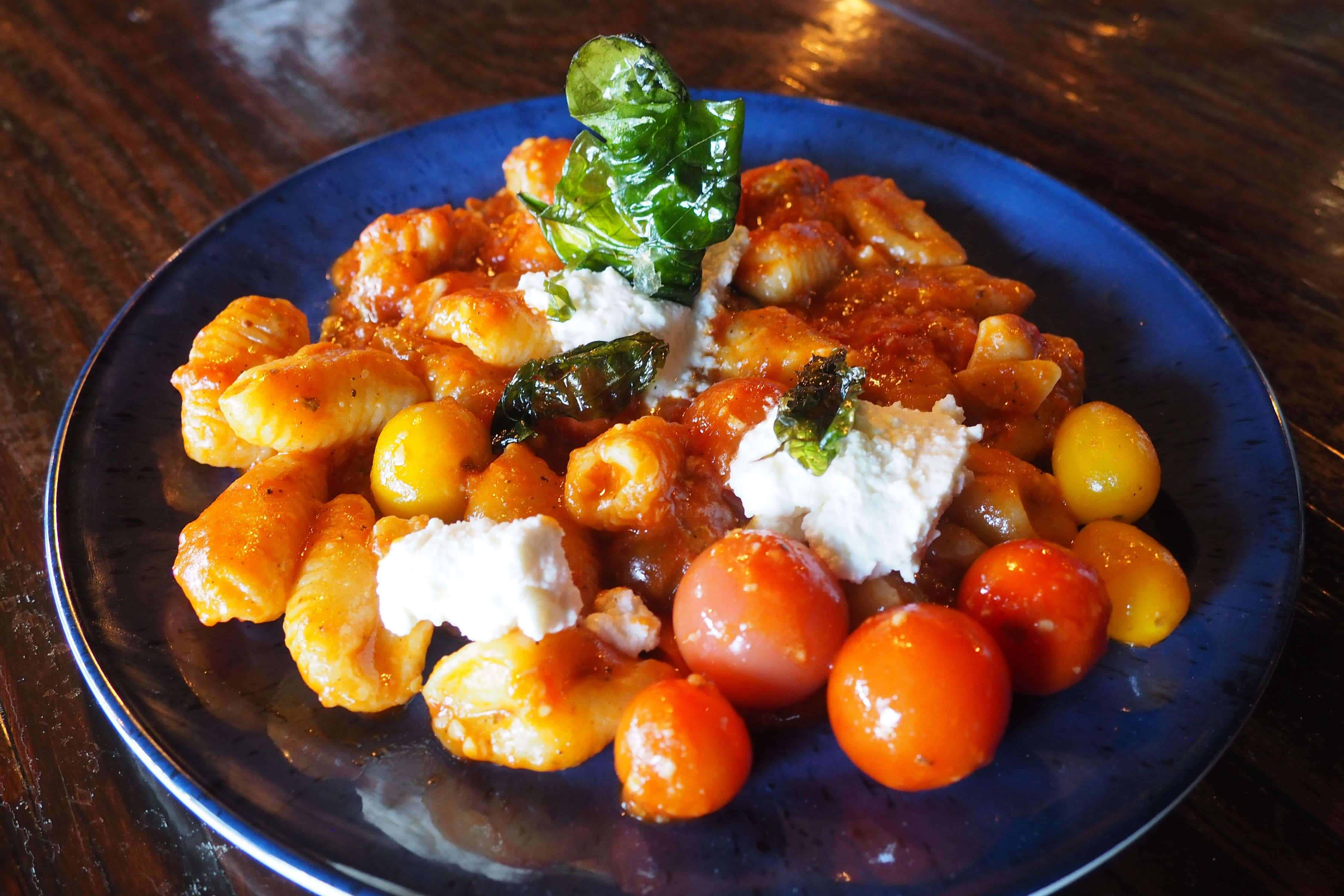 Privateer Goat Cheese Gnocchi with White Wine Tomato Sauce, Ricotta and Basil