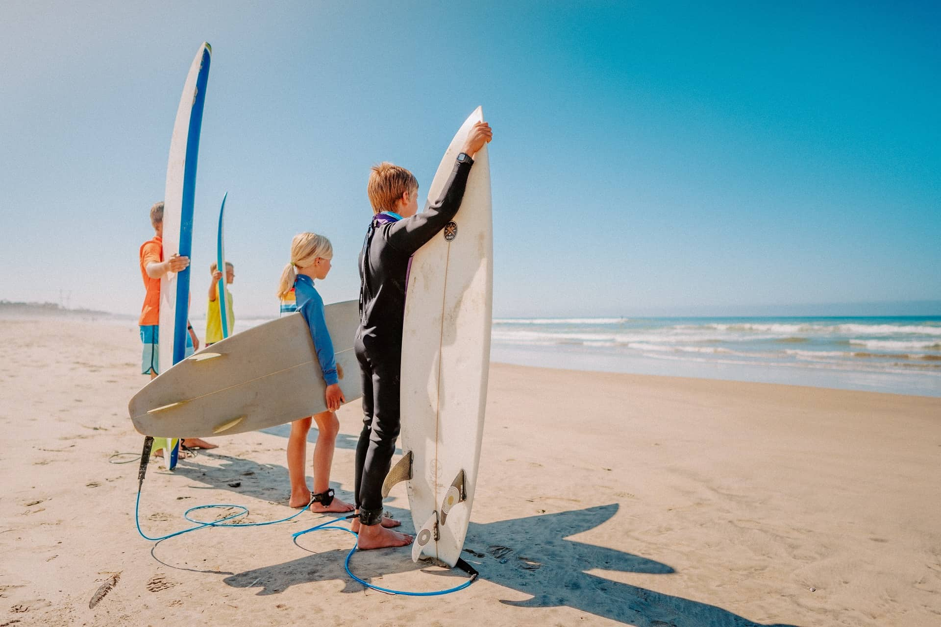 Kids with Surfboards at the Beach